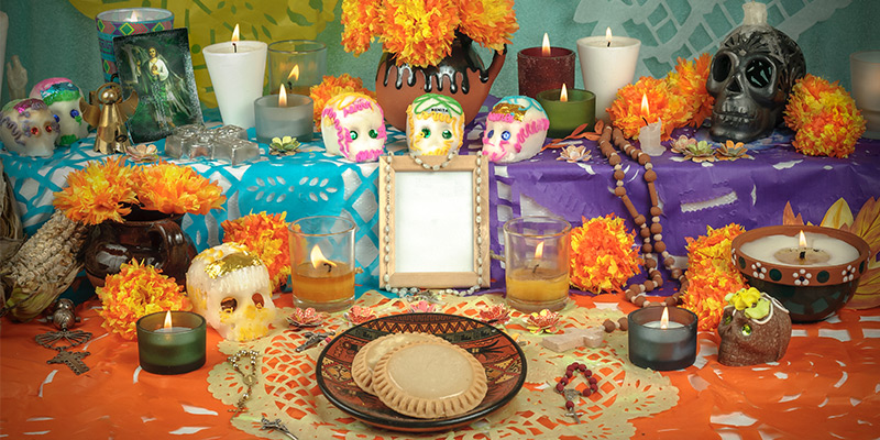 Preparing A Traditional Mexican Altar For The Day Of The Dead